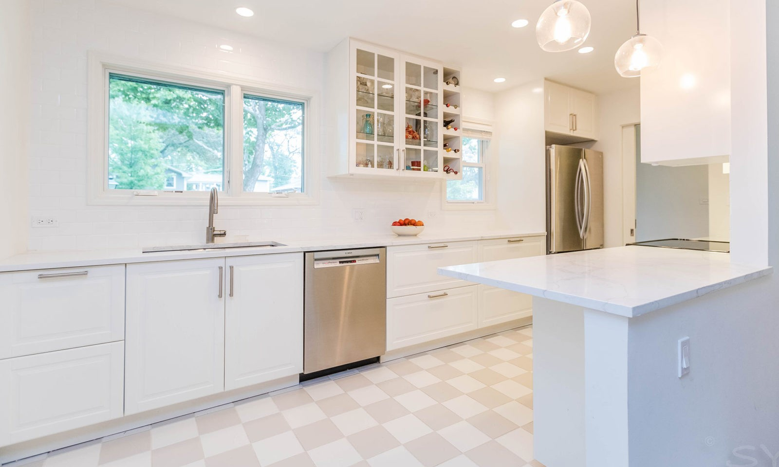 mid century modern ranch renovation and remodel view of white kitchen and sink under window