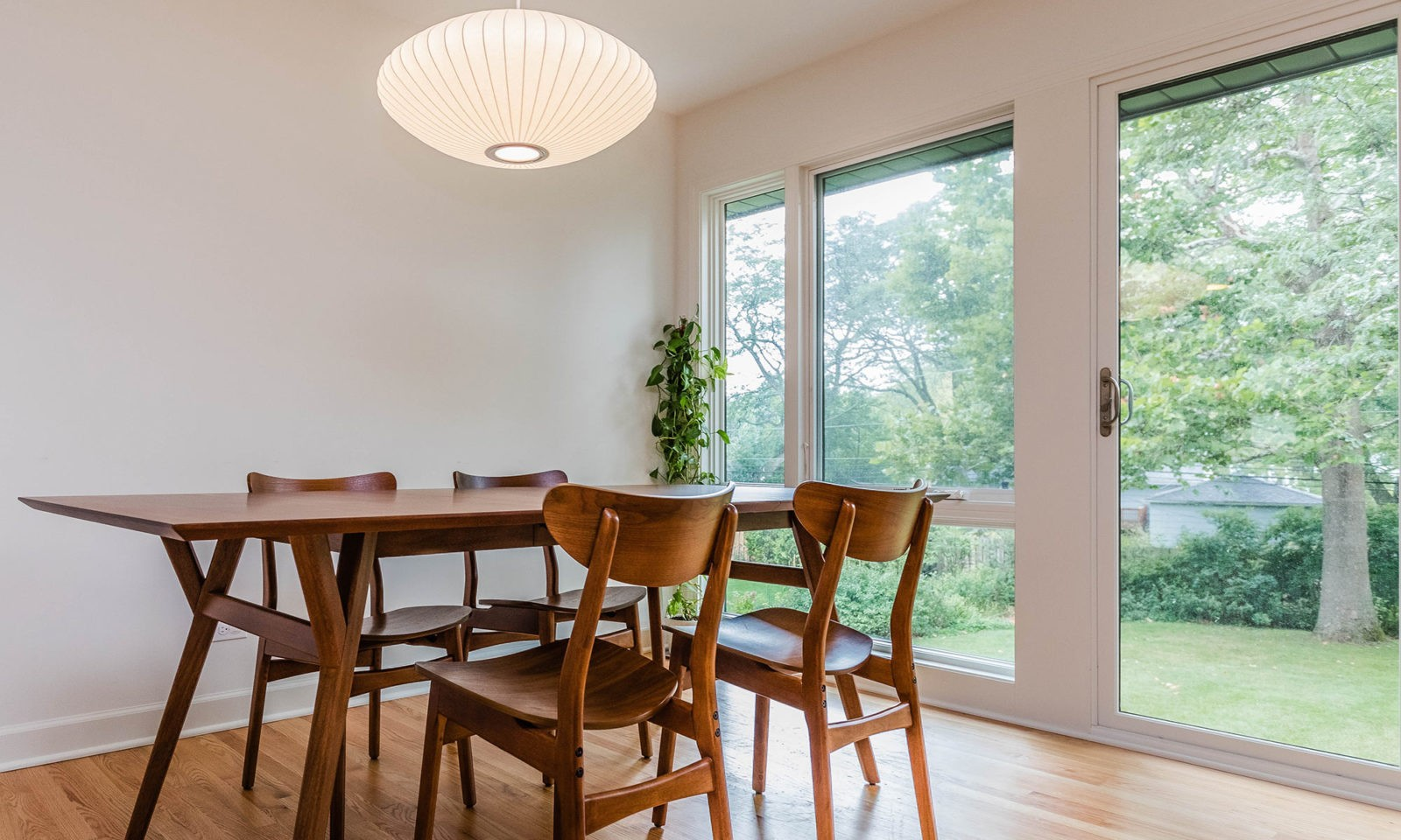 mid century modern ranch renovation and remodel view of dining room with floor to ceiling windows