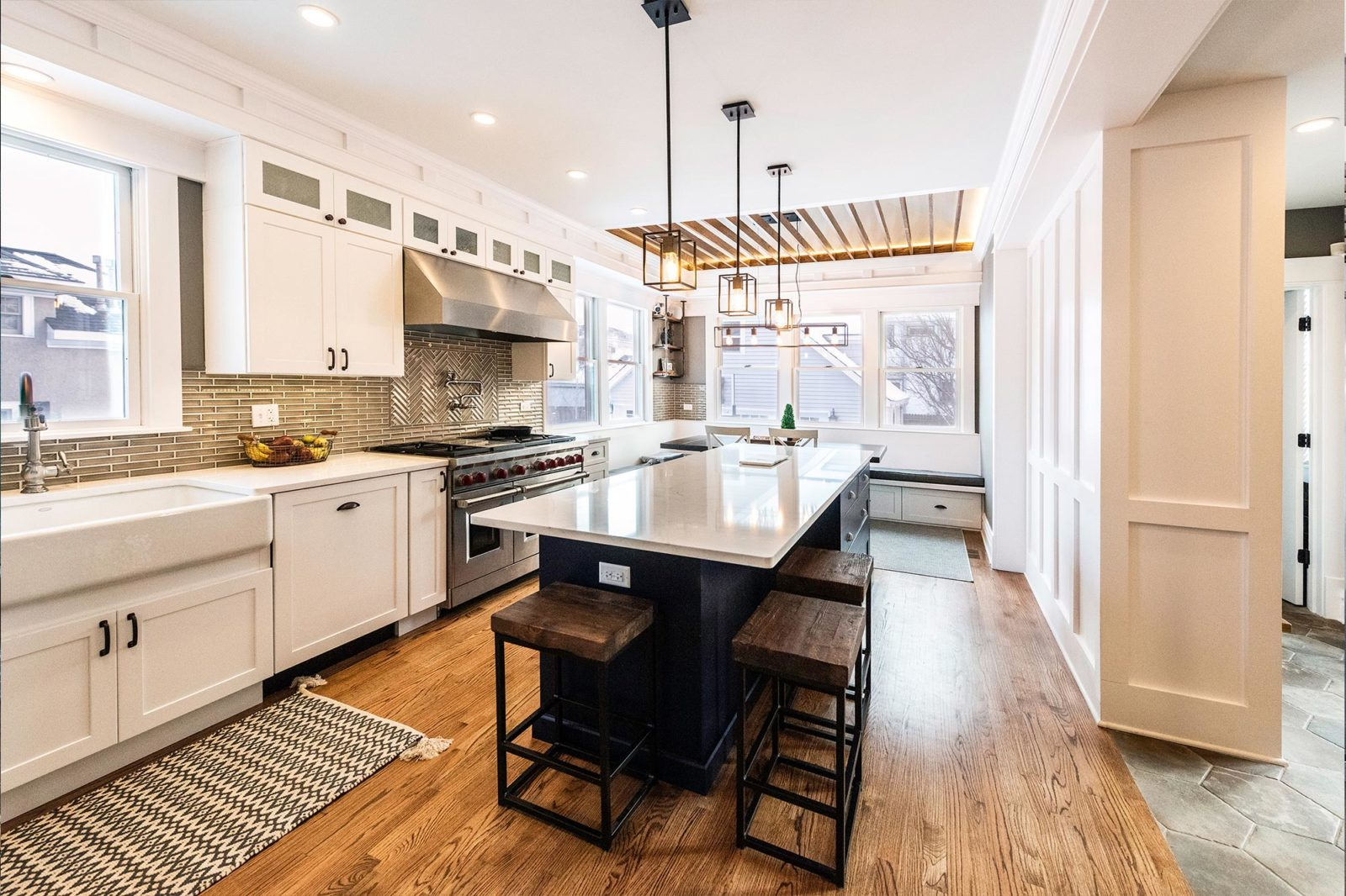 livco kitchen remodel large black island white countertops & cabinets large farmhouse sink