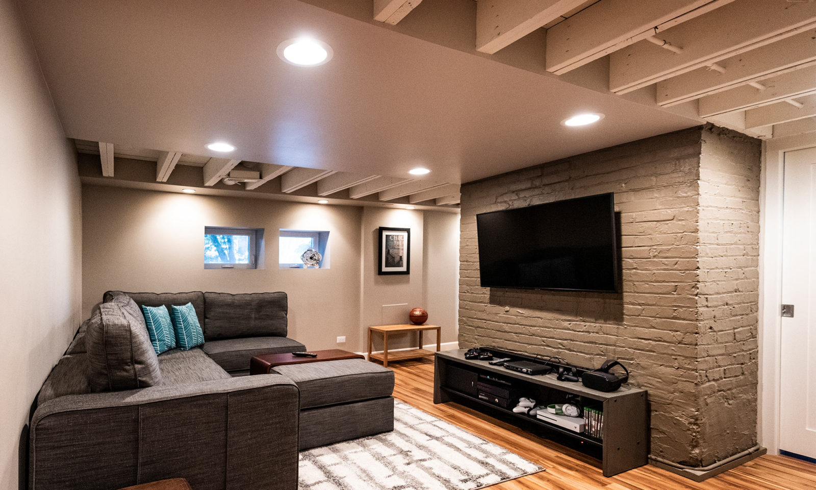 view of new basement rec room and wall mounted TV