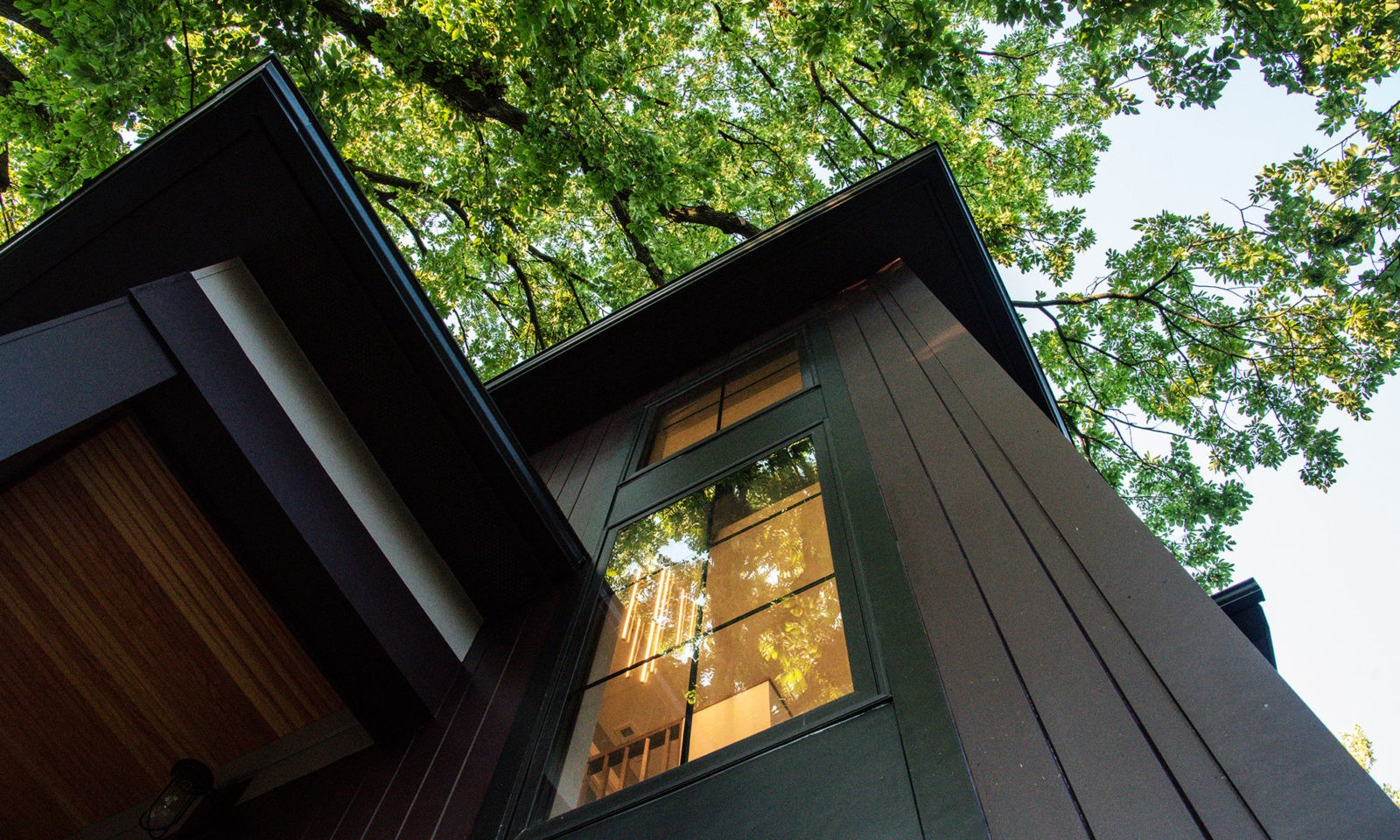 Exterior image of a home looking up into a well lit window