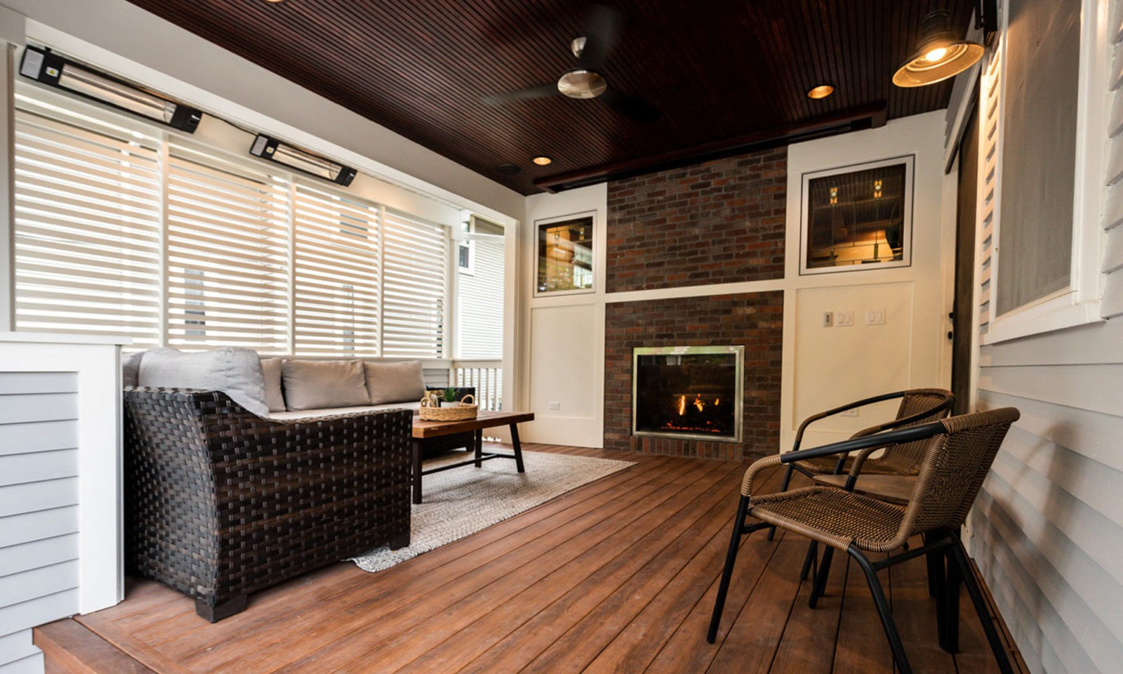 view of fireplace on outdoor living room