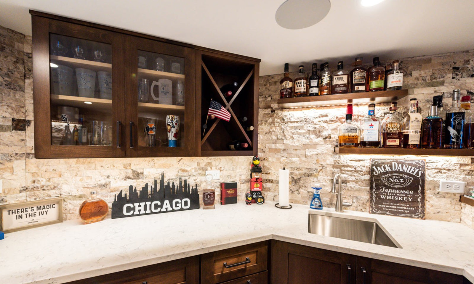 view of basement remodel bar with sports game on TV