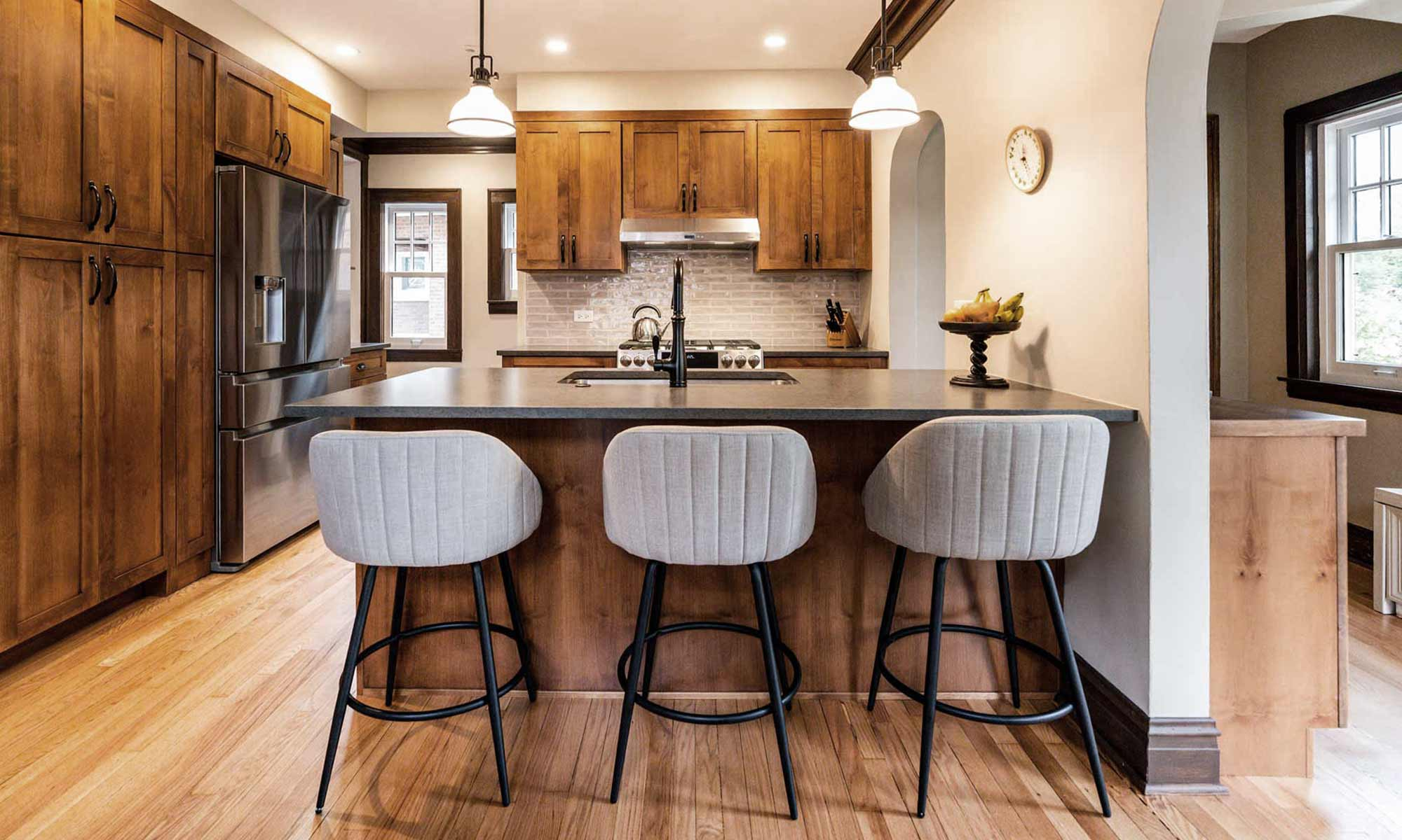 dark wood kitchen cabinets with peninsula seating